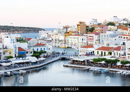 View of town and harbour at dusk, Agios Nikolaos, Lasithi Region, Crete (Kriti), Greece - Stock Photo
