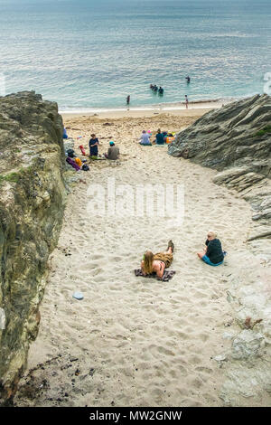 Holidaymakers relaxing on the beach at Little Fistral in Newquay in Cornwall. - Stock Photo
