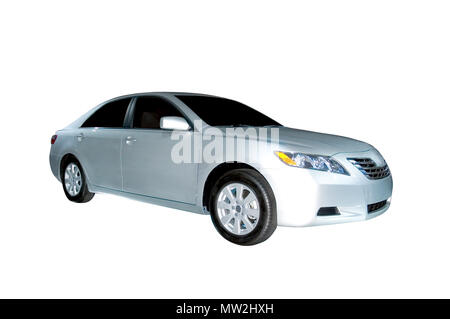 A brand new 2006 Toyota Camry Hybrid model. Isolated on a white background, clipping path is included. More car photos available in my gallery. - Stock Photo