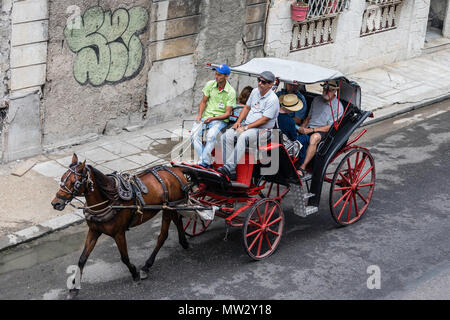 Horse-drawn carts known locally as coaches for hire in Havana, Cuba - Stock Photo