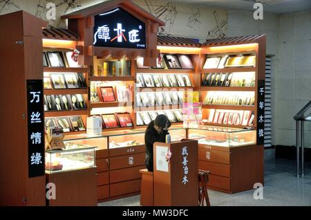 SHENZHEN, CHINA - APRIL 3, 2018: shop offering traditional wooden combs as high-class gifts for Chinese people. - Stock Photo