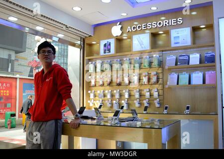 SHENZHEN, CHINA - APRIL 3: SEG famous electronic market in HuaQiangBei road. Official shop offering Apple products on April 3rd, 2018. - Stock Photo