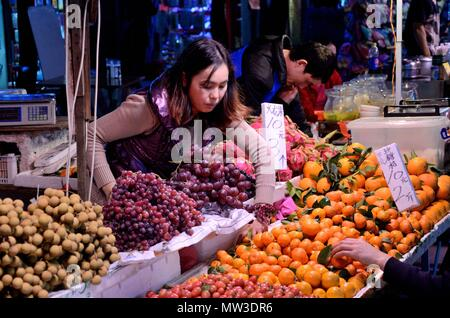 SHENZHEN, CHINA - APRIL 3: night market in Futian, stall with fruits on April 3rd, 2018. - Stock Photo