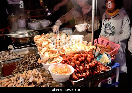 SHENZHEN, CHINA - APRIL 3: night market in Futian, stalls with snacks and fruits on April 3rd, 2018. - Stock Photo
