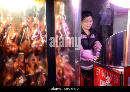 SHENZHEN, CHINA - APRIL 3: night market in Futian, stall with baked ducks and chickens on April 3rd, 2018. - Stock Photo