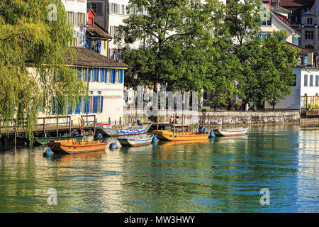 Zurich, Switzerland - 30 July, 2016: boats on the Limmat river in the historic Schipfe quarter. Zurich is the largest city in Switzerland and the capi - Stock Photo