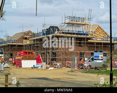 New house covered in scaffolding at a new housing development on the former Mount Oswald golf course, Durham,England - Stock Photo