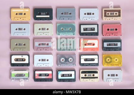 Set of retro cassette tapes on pink background. Top view. Flat lay. - Stock Photo