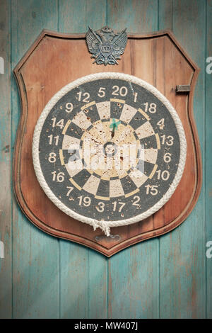 Old dartboard on old wood background. Top view. Flat lay. - Stock Photo
