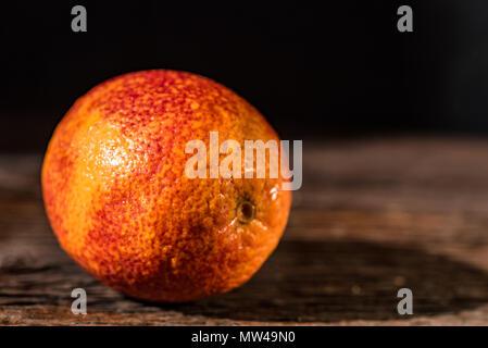 Whole ripe juicy Sicilian Blood orange - Stock Photo