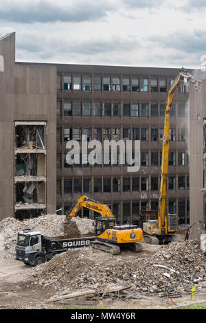 High view of demolition site with heavy machinery (excavators & dumper truck) working & demolishing office building - Hudson House  York, England, UK. - Stock Photo