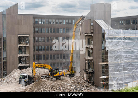 High view of demolition site with rubble, heavy machinery (excavators) working & demolishing empty office building - Hudson House  York, England, UK. - Stock Photo