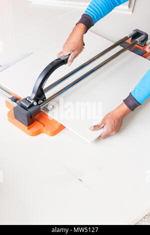 Industrial Tiler Builder Worker Working With Floor Tile Cutting