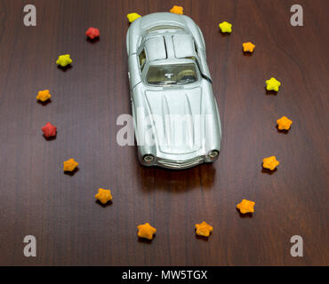 top view of toy car in sugar stars in form circle. - Stock Photo
