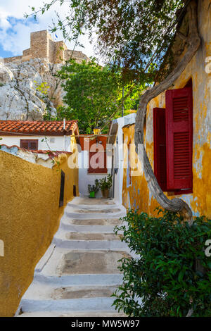 View of Acropolis from Anafiotika neighborhood in the old town of Athens, Greece. - Stock Photo