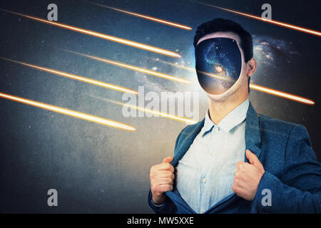 Young man with cosmos instead his face, tearing off his jacket. Space galaxy inside human head. Fantasy futuristic background with falling comets and  - Stock Photo