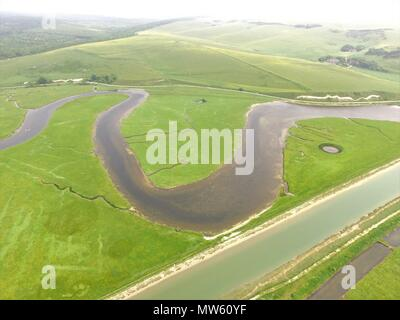 Aerial drone image of the River Cuckmere in East Sussex, England. - Stock Photo