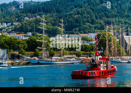 Tall Ships Race Bergen 2014. Polish brig Fryderyk Chopin. Behind it, Polish three masted barquentine Pogoria. A local tug boat attending. - Stock Photo