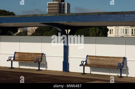 Benches on the seafront promenade at Southsea in Portsmouth, Hampshire, England - Stock Photo