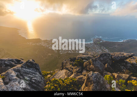 Sunset view of Camps Bay from Table Mountain in Cape Town - Stock Photo