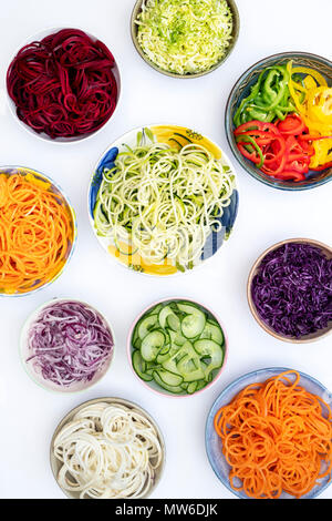 Spiralized Vegetables in bowls on a white background. Pattern - Stock Photo