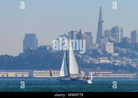 San Francisco skyline as seen from the water with sailboat. - Stock Photo