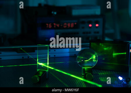 Experiment in photonic laboratory with laser - Stock Photo