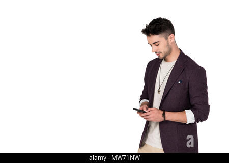 Stylish handsome young man using smartphone isolated on white - Stock Photo