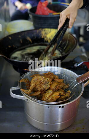 Deep Fried Chicken with Tasty Crisp Topping selling at street market food - Stock Photo