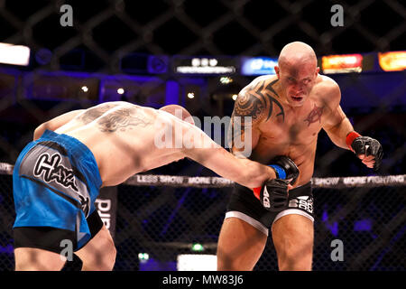 Mixed Martial Arts (MMA) fighter Shaun Hampton catches Gaz Corran in the chest with a right hook at ACB 54 in Manchester, UK. Corran would ultimately win the fight by unanimous decision. Absolute Championship Berkut, Mixed Martial Arts, MMA fight. - Stock Photo