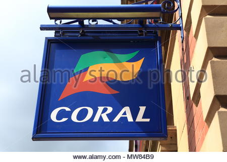 Advertising Sign For Coral Bookmakers Fixed To Wall At Ashton-Under-Lyne Tameside Lancashire England June 2018 - Stock Photo
