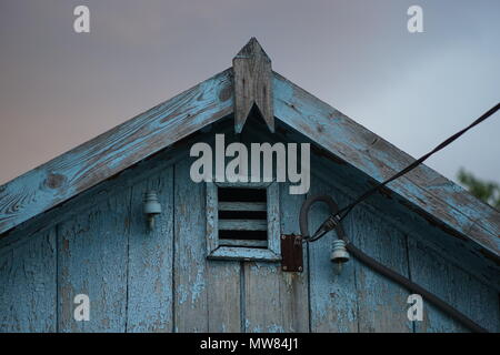 Part of the old roof with shabby blue paint - Stock Photo