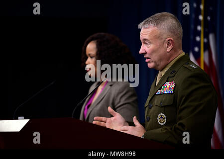 Dana White, the assistant to the secretary of defense for public affairs, and U.S. Marine Corps Lt. Gen. Kenneth F. McKenzie, the Joint Staff director, brief the press at the Pentagon in Washington, D.C., May 31, 2018. (DoD photo by Master Sgt. Angelita M. Lawrence) - Stock Photo