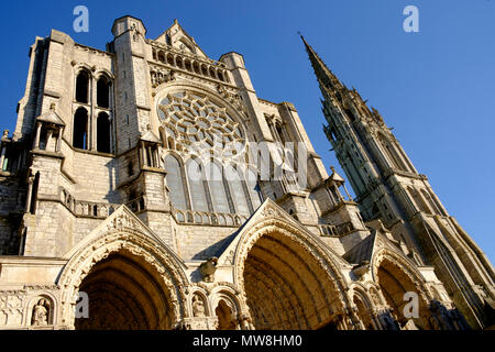 North entrance and the 16th-century Flamboyant spire of Chartres Cathedral, France - Stock Photo