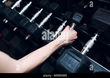 Hand and dumbbells. Fitness in gym. - Stock Photo