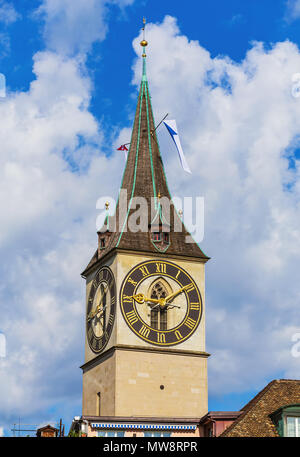 Clock tower of the St. Peter Church in Zurich, Switzerland - a well-known architectural landmark of the city. - Stock Photo