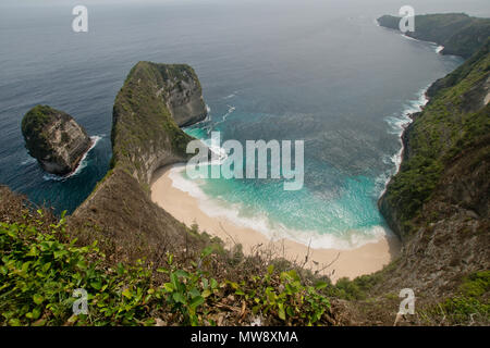 Beach with turquoise water among the rocks. Tropical beach among rocky cliffs. Karang Dawa, Manta Bay or Kelingking Beach on Nusa Penida Island, Bali, Indonesia.Travel concept. - Stock Photo