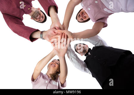 Low Section View Of Smiling Young Hotel Staff Stacking Their Hands - Stock Photo