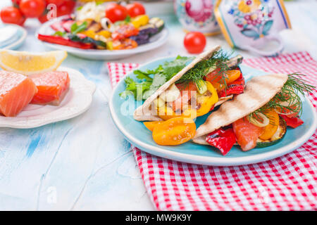 Mexican tacos with grilled vegetables and salmon. Healthy food for lunch. Fast food. Copy space - Stock Photo