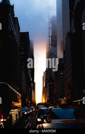 The street view of Manhattanhenge on 57th street in Manhattan. - Stock Photo