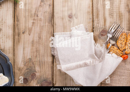 Gray textile napkin on a wooden table. place for text. Copy space. Flat lay - Stock Photo
