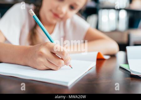 cute cute little girl doing homework - Stock Photo