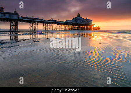 Eastbourne Pier in East Sussex captured at sunrise - Stock Photo