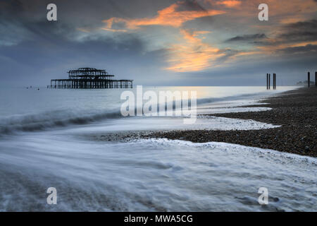 The remains of West Pier captured from Brighton Beach. - Stock Photo