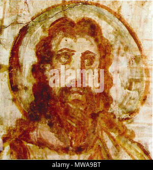. English: Mural painting from the catacomb of Commodilla. Bust of Christ. This is one of first bearded images of Christ, during the 4th century Jesus was beginning to be depicted as older and bearded, in contrast to earlier Christian art, which usually showed a young and clean-shaven Jesus. Italiano: Cristo barbato (dettaglio), affresco 60x72, fine IV-inizio V secolo, Catacombe di Commodilla, Roma. 4th century AD. Anonymous 139 Comodilla Catacomb Iesus 4th century - Stock Photo