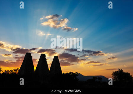 The sun sets behind the 16th century SMELTERS or HORNOS at the SANTA BRIGIDA MINE - MINERAL DE POZOS, MEXICO - Stock Photo
