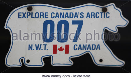 Vehicle licence plate from the Canadian Northwest Territories in the shape of a polar bear. - Stock Photo