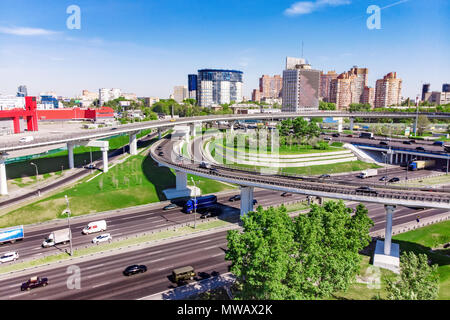 Aerial view of a freeway intersection. Road junctions in a big city - Stock Photo