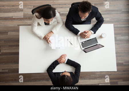 Hr managers interviewing female job applicant, top view from abo - Stock Photo