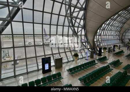 Thai Airways aircraft as seen from the departure terminal. Suvarnabhumi Airport. Bangkok. Thailand - Stock Photo